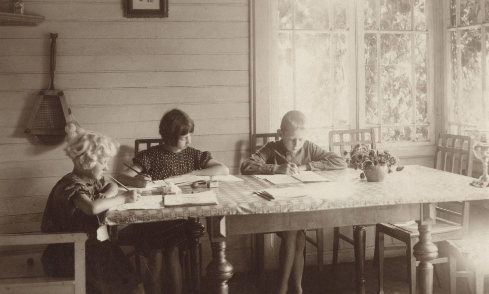 The Neiburgs family children studying in the sun lounge of their country house in Pluģi, Jelgava District.
