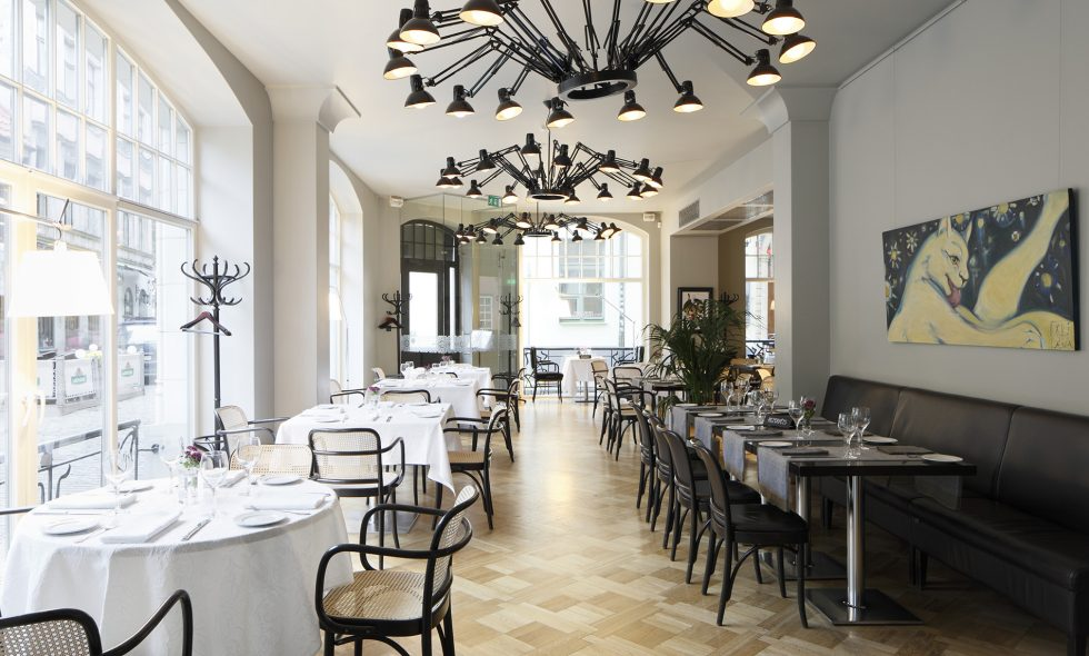 Restaurant Neiburgs — Light Art Nouveau-style restaurant with parquet floors, Thonet furniture, MOOOI Dear Ingo ceiling lamps