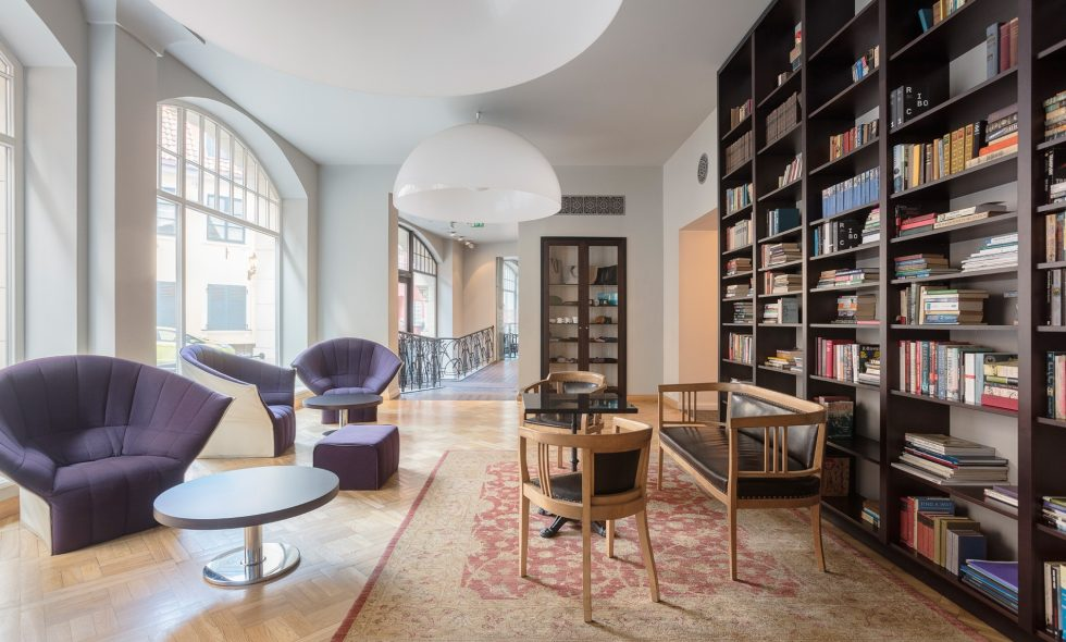 Library with a vast selection of books in a range of languages. Renovated antique Thonet furniture, an Artemide designer lamp