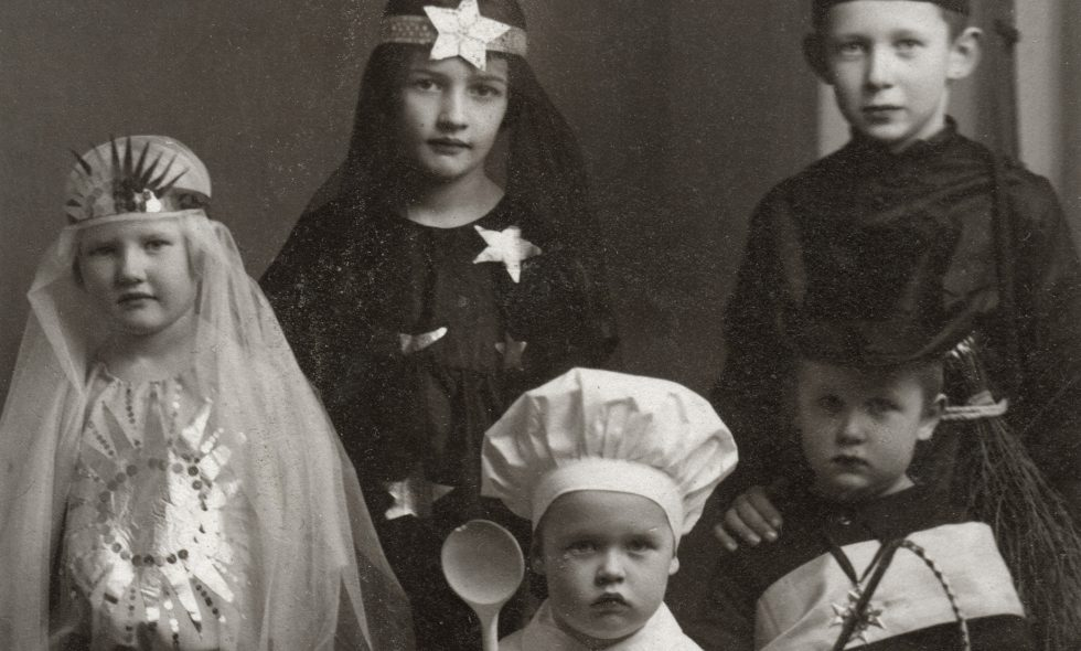 The Neiburgs family children wearing carnival costumes, circa 1927.
