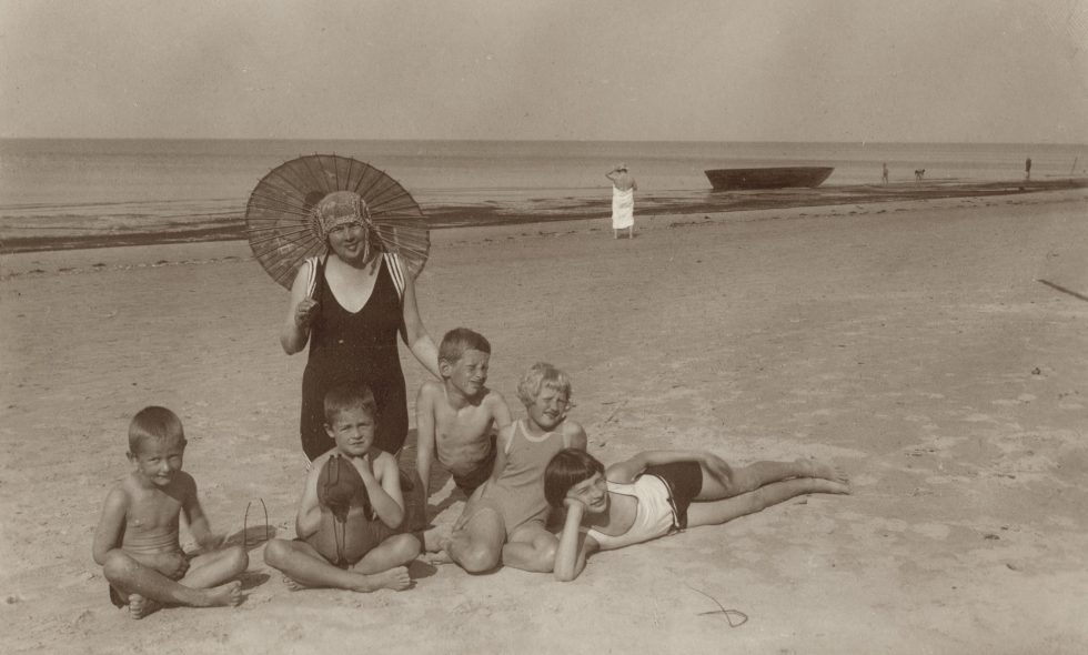 Alma Neiburgs with children wearing vintage swimsuits on the beach in Bulduri, circa 1925