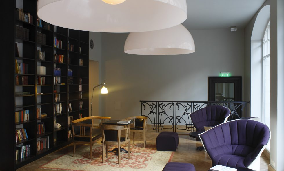 Library features large windows, Ligne Roset armchairs, Zava Ociu ceiling lamps, renovated antique Thonet furniture