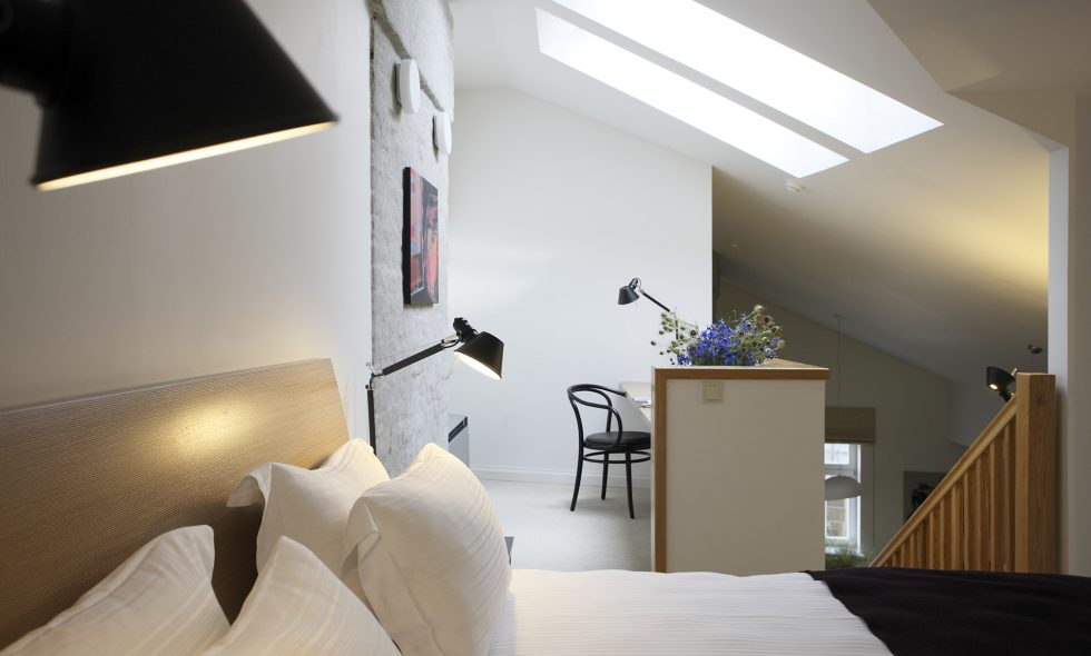 Two-Storey Deluxe Suite — Second-floor bedroom and comfortable work place, Artemide designer lamps, soft flooring