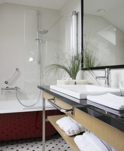 Two-Storey Suites — Roomy and comfortable bathroom with shelves, bathrobes, bathroom cosmetics